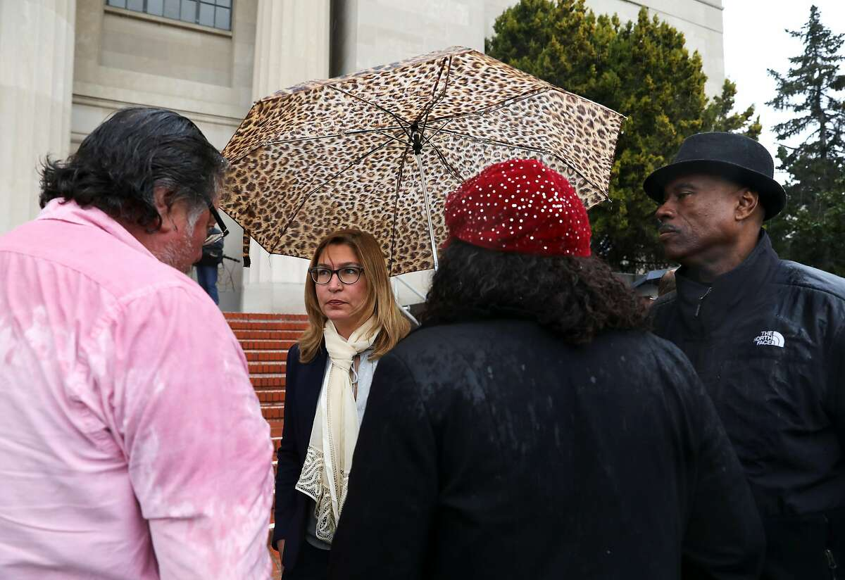ACLU attorney Kathleen Guneratne (second from left) stands outside the Contra Costa City Superior Court with Cephus Johnson (right), the uncle of the late Oscar Grant, following a hearing where attorneys for police unions faced off against the ACLU over the new police transparency law, SB1421, in Martinez, Calif., on Friday, February 8, 2019. Grant was fatally shot by a BART police officer on January 1, 2009. Unions argue that 1421 cannot be applied