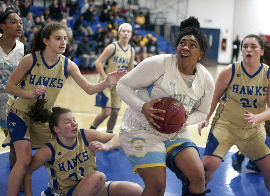 After snagging a rebound, Kolbe Cathedral's Shaniya Stancil (45) prepares go to the basket against Newtown on Friday night in Bridgeport. Photo: Christian Abraham / Hearst Connecticut Media / http://connpost.com/