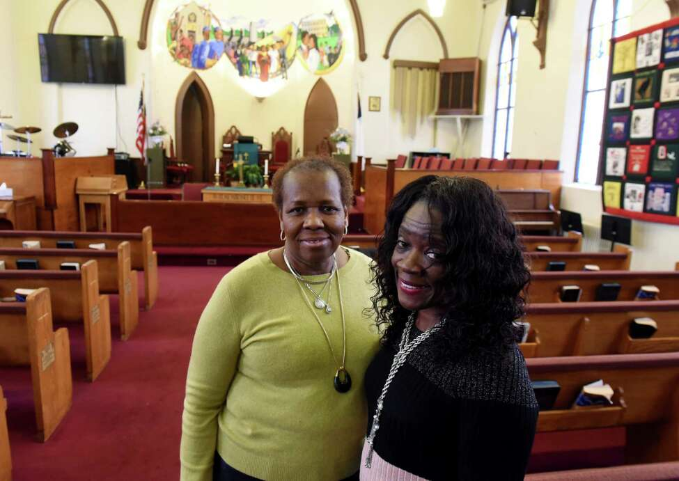 Israel African Methodist Episcopal Church members; Caroline Williams, director of Christian education and resident historian, left, and Donna Walker, vice chair of the board stewards, right, stand inside the church on Tuesday, Jan. 29, 2019, in Albany, N.Y. The Hamilton Street church is hosting events on February 10 and 24 to celebrate its 190th anniversary. Williams and Walker are (Will Waldron/Times Union)