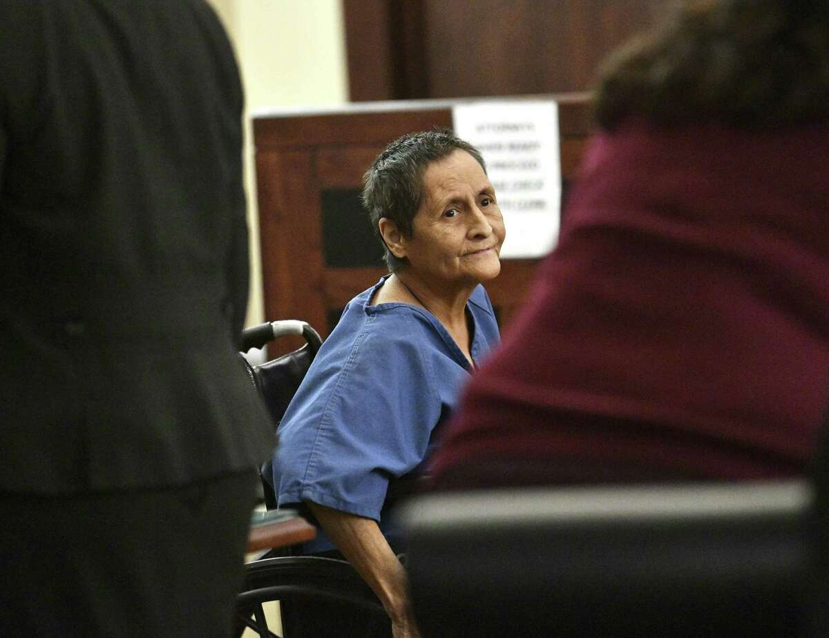 Beatrice Sampayo, 64, who is accused of helping cover up the death of her 8-month-old grandson, King Jay Davila, is wheeled through the courtroom during a bail hearing on Feb. 8, 2019. Magistrate Judge Andrew Carruthers reduced bail from $250,000 to $50,000.