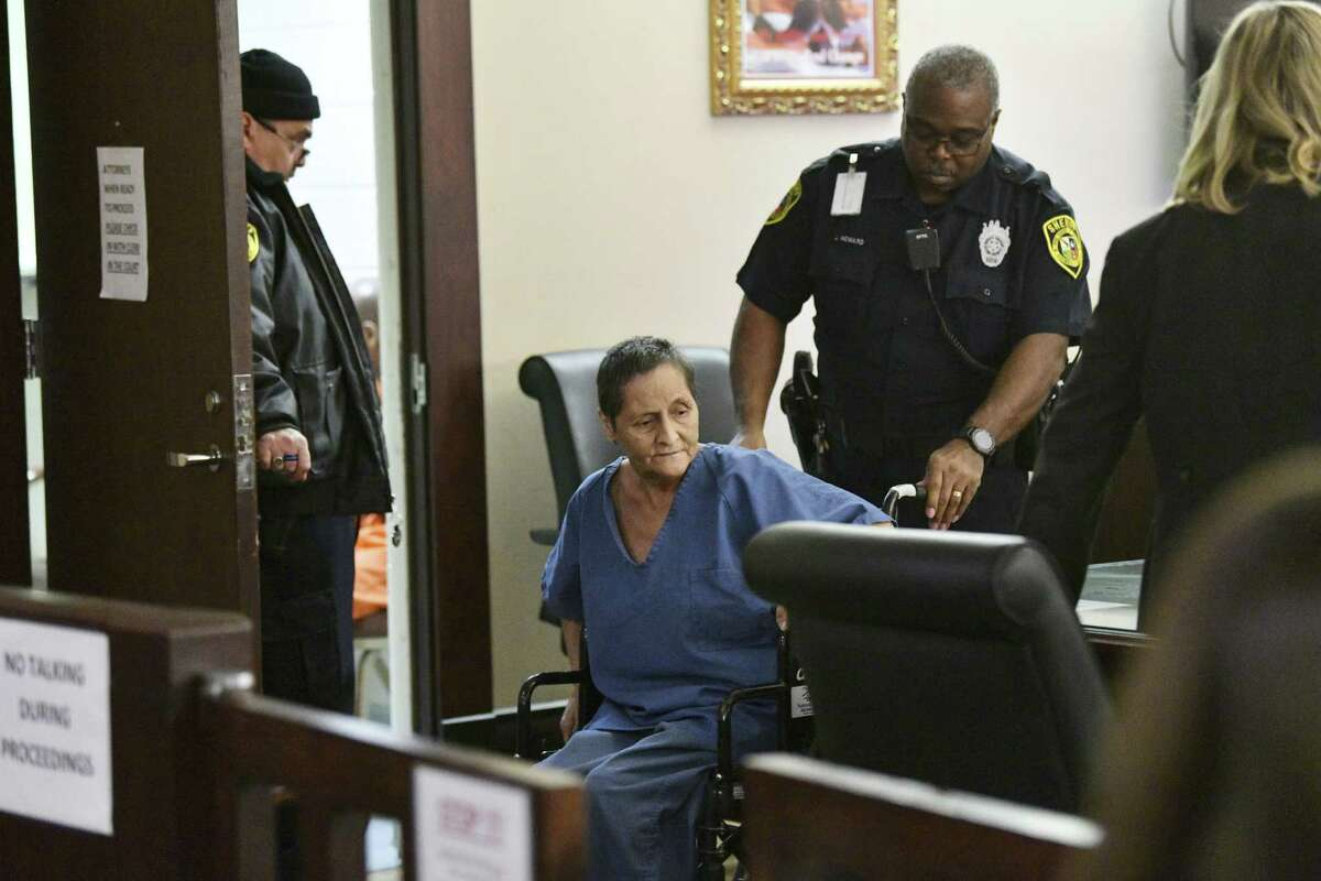 Beatrice Sampayo, 64, who is accused of helping cover up the death of 8-month-old King Jay Davila, is wheeled through the courtroom during a bail hearing on Feb. 8, 2019. Her bail was reduced and she was released from jail. Her son, Christopher Davila, is accused in King Jay's death.