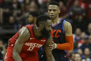 Oklahoma City Thunder guard Russell Westbrook (0) is defensing Houston Rockets guard James Harden (13) during the fourth quarter of the NBA game at Toyota Center on Tuesday, Dec. 25, 2018, in Houston. The Houston Rockets defeated the Oklahoma City Thunder 113-109.