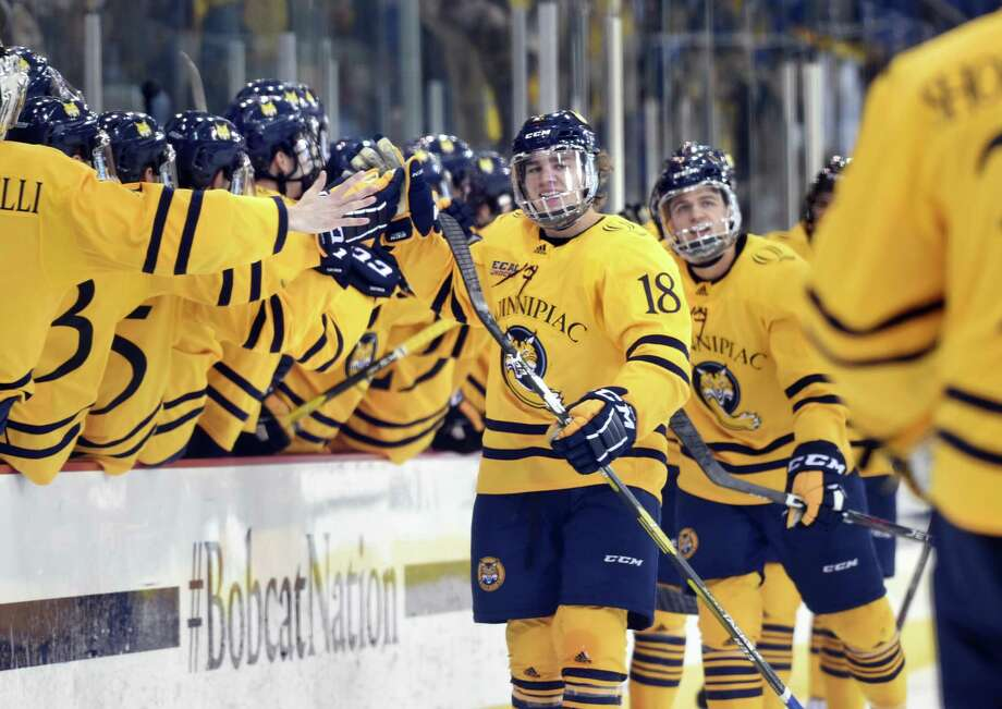 Quinnipiac's Nick Jermain, center, celebrates after scoring against Yale in the first period in Hamden on Friday. Photo: Arnold Gold / Hearst Connecticut Media / New Haven Register
