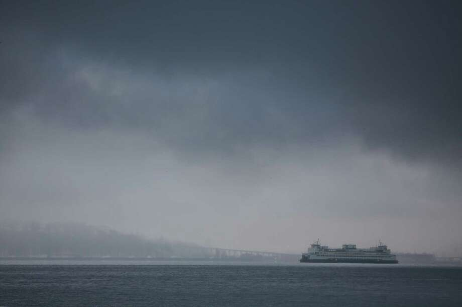 A Washington State Ferry moves across Elliott Bay as snow falls Friday afternoon in West Seattle, beginning what is expected to be a heavy storm that continues into Saturday and brings several inches of snow to Seattle, Jan. 8, 2019. Photo: Genna Martin, Seattlepi.com / SeattlePI