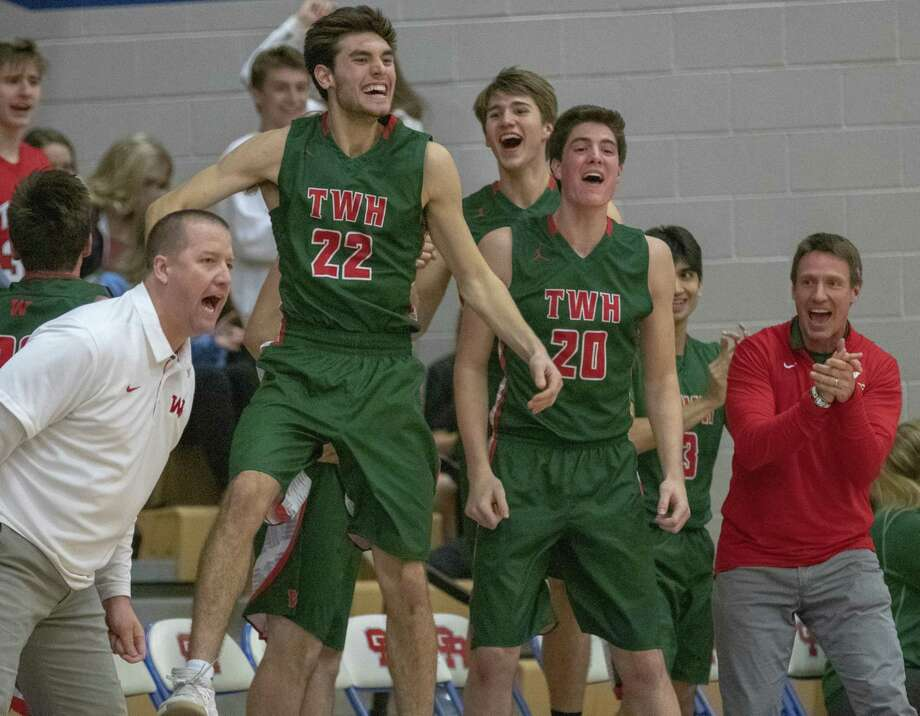 The Woodlands High School celebrates after scoring during a District 15-6A high school basketball game Friday, Feb. 8, 2019 at Oak Ridge High School in Oak Ridge North. Photo: Cody Bahn, Houston Chronicle / Staff Photographer / © 2018 Houston Chronicle