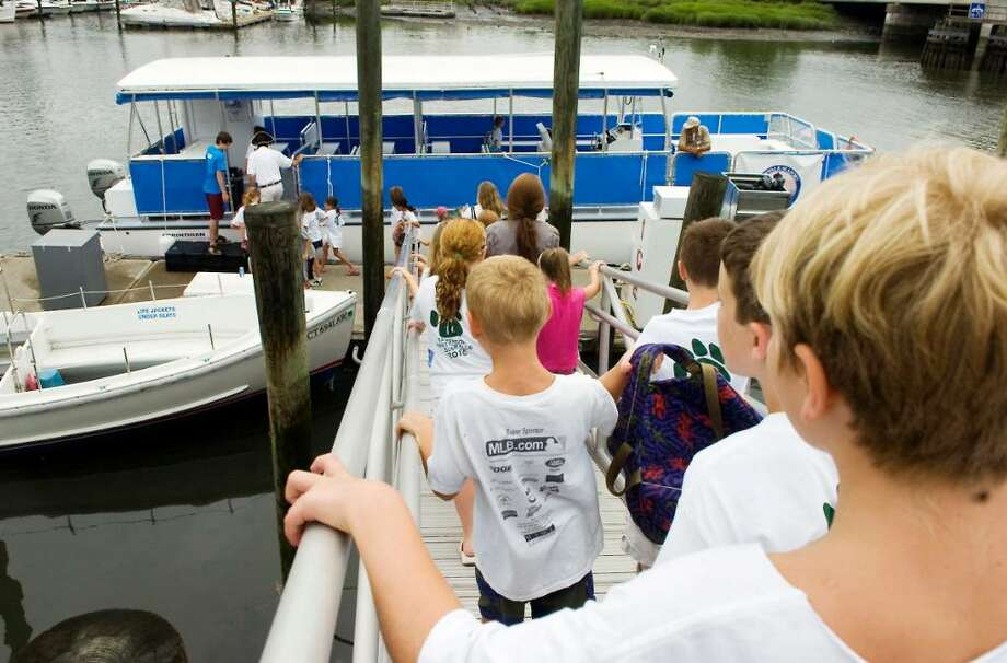 A group of campers board the Norwalk Seaport Association's boat on a dock at the Maritime Aquarium at Norwalk to cruise out to Sheffield Island in Norwalk, Conn. on Thursday July 15, 2010. Photo: Kathleen O'Rourke / Stamford Advocate