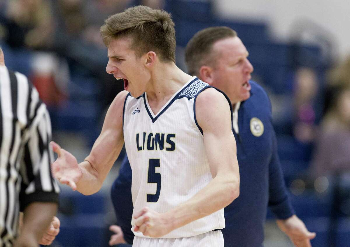 FILE PHOTO - Lake Creek point guard Pierce Spencer (5) reacts after making a jump shot to end the first quarter of a District 20-5A high school basketball game, Tuesday, Jan 29, 2019, in Montgomery. Lake Creek clinched its first-ever playoff appearance on Friday with an overtime win against Caney Creek. Spencer led the Lions with a game-high 26 points.