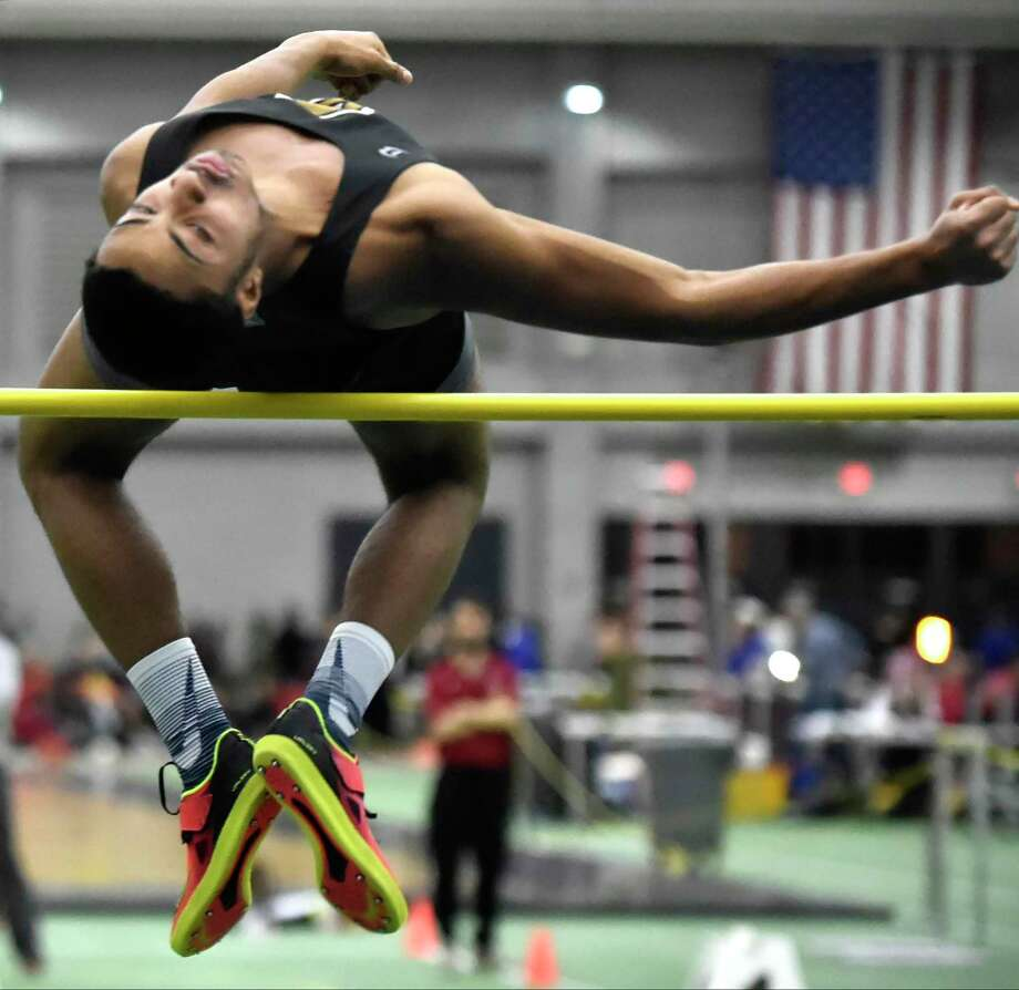 Amity's Shaun Graham wins the high jump during the Class L indoor track championship Friday in New Haven. Photo: Peter Hvizdak / Hearst Connecticut Media / New Haven Register