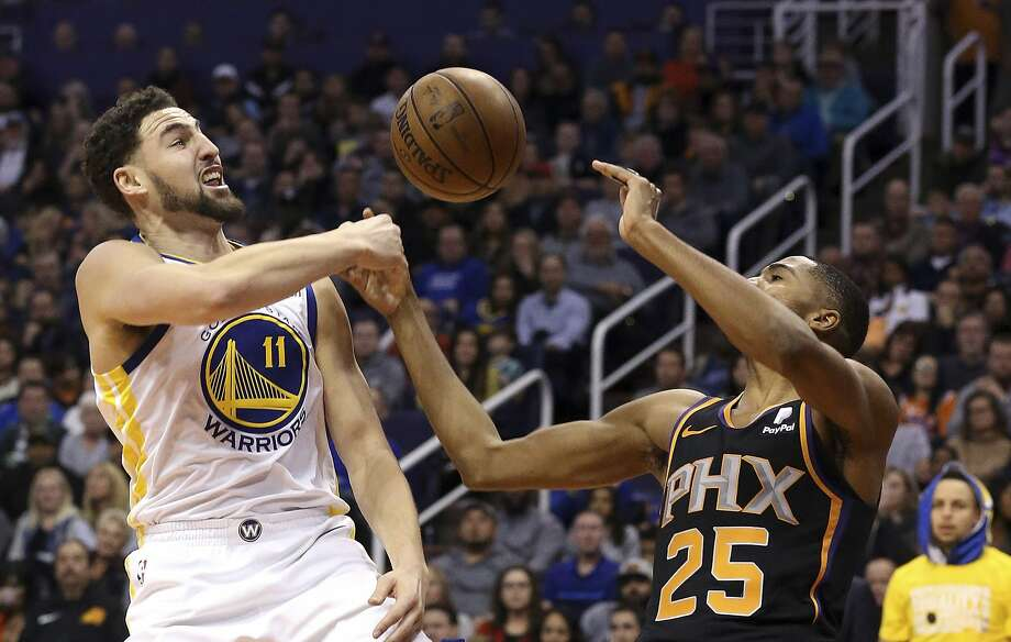 Golden State Warriors guard Klay Thompson (11) blocks the shot of Phoenix Suns forward Mikal Bridges (25) during the second half of an NBA basketball game Friday, Feb. 8, 2019, in Phoenix. The Warriors defeated the Suns 117-107. (AP Photo/Ross D. Franklin) Photo: Ross D. Franklin / Associated Press