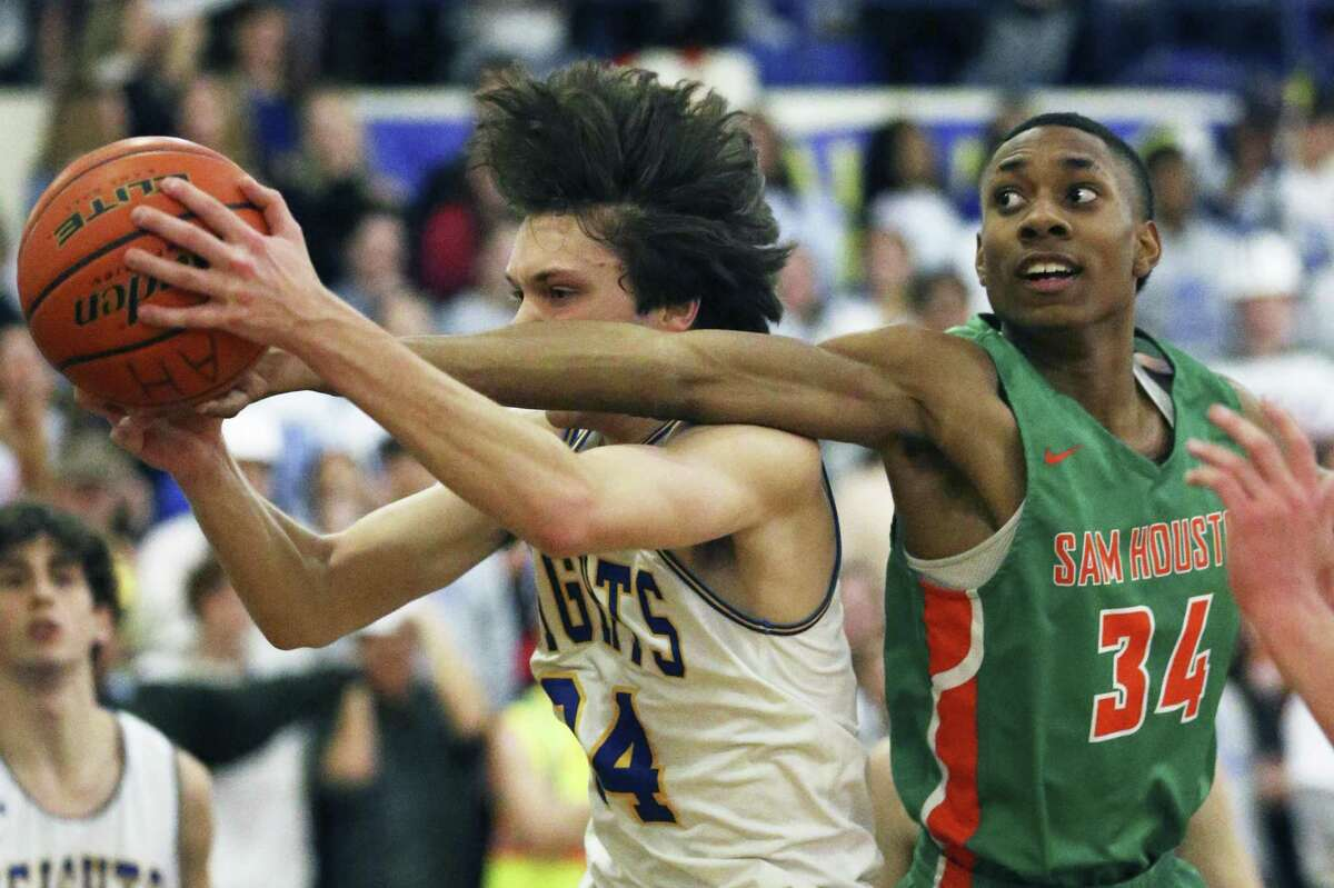 Sam Houston's Aviar Smith (right) had 14 points during the Hurricanes' 54-44 win vs. Edison on Tuesday.