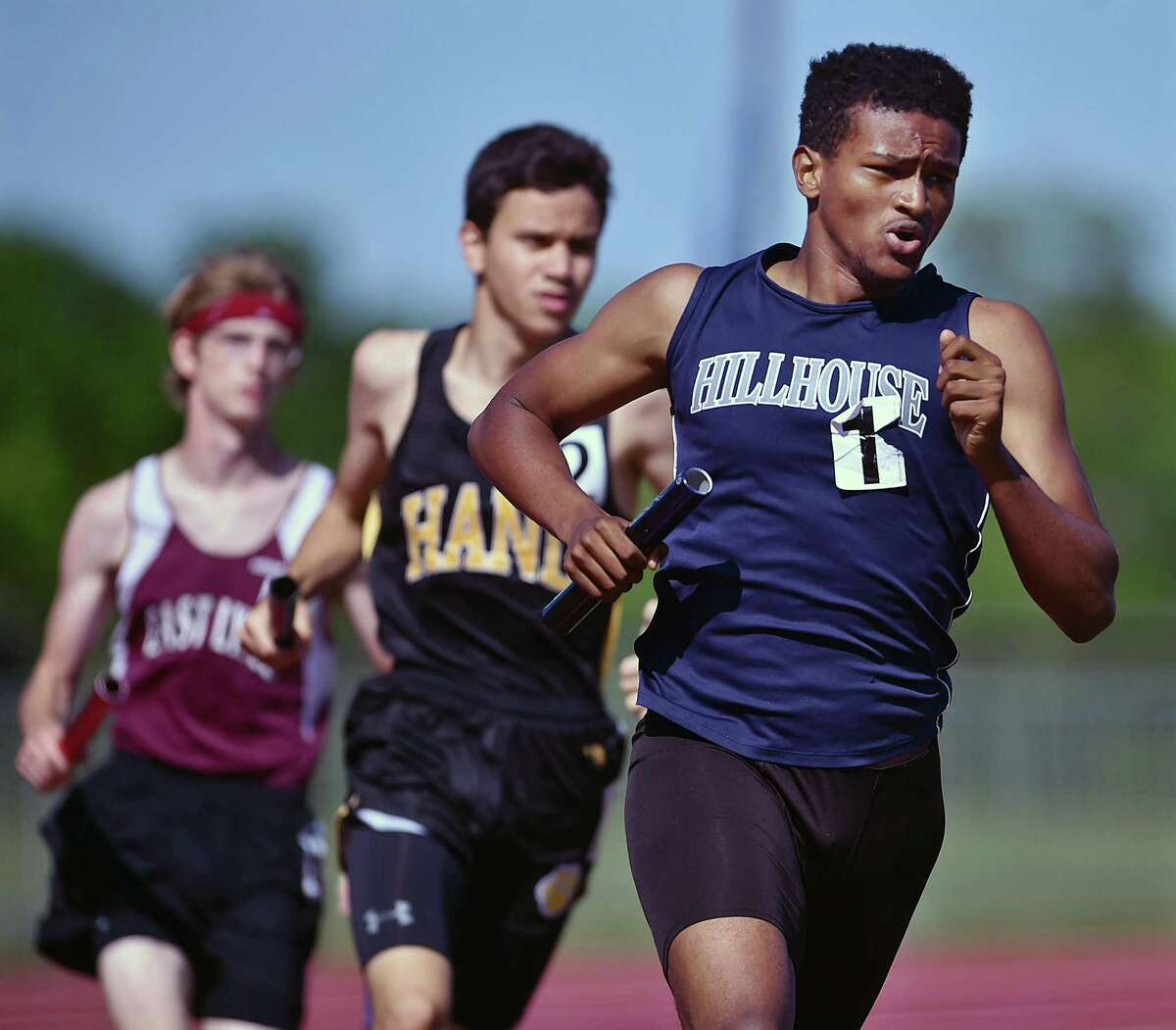Senior Manasseh Bekele runs the final leg of the 4x800 relay, propelling Hillhouse to first place at the Class MM championship in 2018.