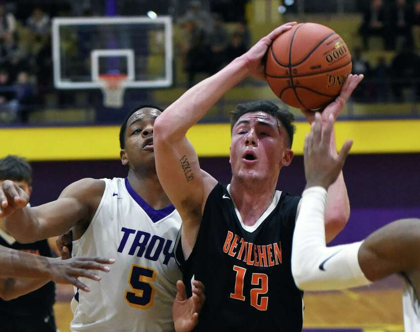 Bethlehem guard Michael Ortale drives the ball toward the basket during a game against Troy on Friday, Feb. 8, 2019 at Troy High School in Troy, NY. (Phoebe Sheehan/Times Union) ORG XMIT: 40046118A