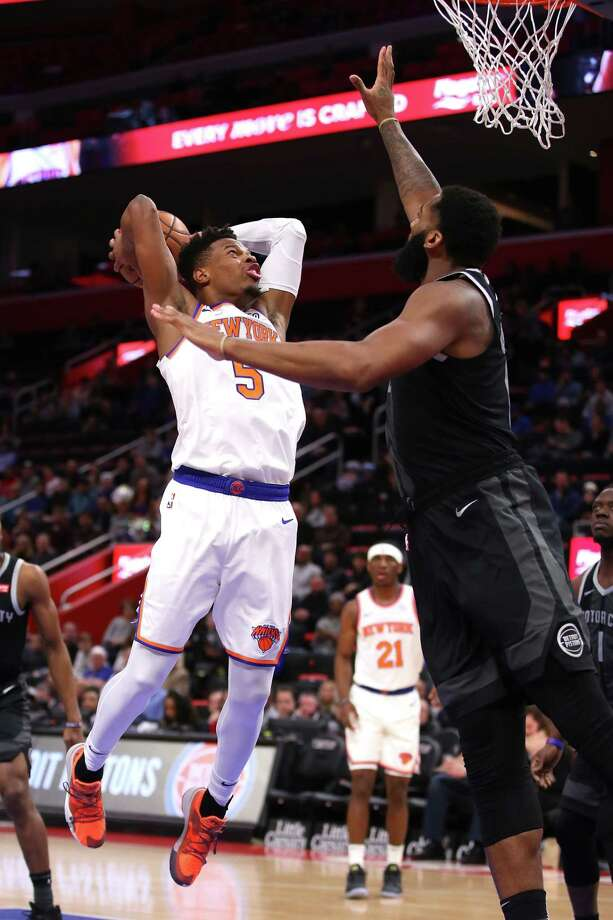 DETROIT, MICHIGAN - FEBRUARY 08:  Dennis Smith Jr. #5 of the New York Knicks drives to the basket against Andre Drummond #0 of the Detroit Pistons during the first half at Little Caesars Arena on February 08, 2019 in Detroit, Michigan. NOTE TO USER: User expressly acknowledges and agrees that, by downloading and or using this photograph, User is consenting to the terms and conditions of the Getty Images License Agreement. (Photo by Gregory Shamus/Getty Images) Photo: Gregory Shamus / 2019 Getty Images