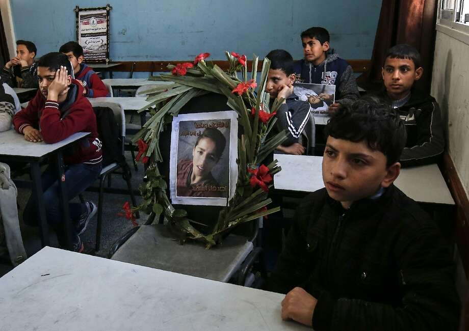 "The empty chair of Hassan Shalabi, 14, is replaced by a wrath bearing his picture, as his classmates mourn his death at his school in Khan Yunis in the southern Gaza Strip, on February 9, 2019 - Two Palestinian teenagers were killed by Israeli fire yesterday, during clashes along the Gaza border, the health ministry in the Hamas-run enclave said. Shalabi, was killed by ""live fire to the chest east of Khan Yunis"", the ministry said. (Photo by SAID KHATIB / AFP)SAID KHATIB/AFP/Getty Images Photo: SAID KHATIB;Said Khatib / AFP / Getty Images"
