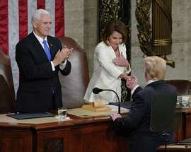 President Donald Trump shakes hands House Speaker Nancy Pelosi of Calif as Vice President Mike Pence looks on after delivery his State of the Union address to a joint session of Congress on Capitol Hill in Washington Feb. 5.