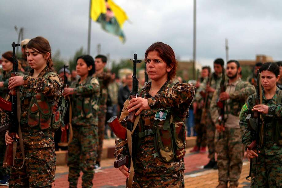 Fighters from the Kurdish women's protection units attend the funeral of a fellow fighter who was killed while battling Islamic State militants in the northeastern Syrian city of Qamishli. Photo: Delil Souleiman / AFP / Getty Images