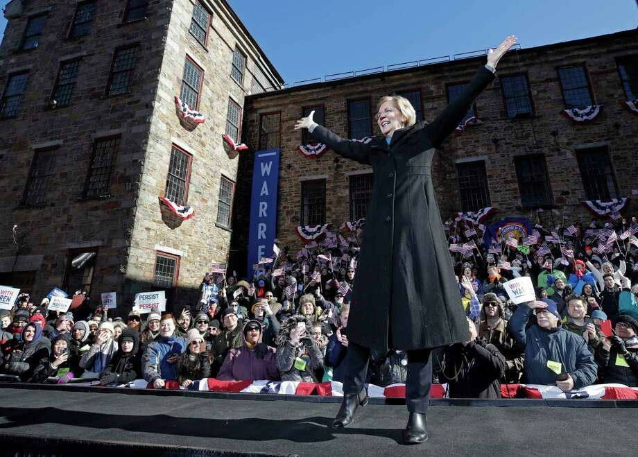 Sen. Elizabeth Warren, D-Mass., acknowledges cheers as she takes the stage during an event to formally launch her presidential campaign, Saturday, Feb. 9, 2019, in Lawrence, Mass. Photo: Elise Amendola, AP / Copyright 2019 The Associated Press. All rights reserved
