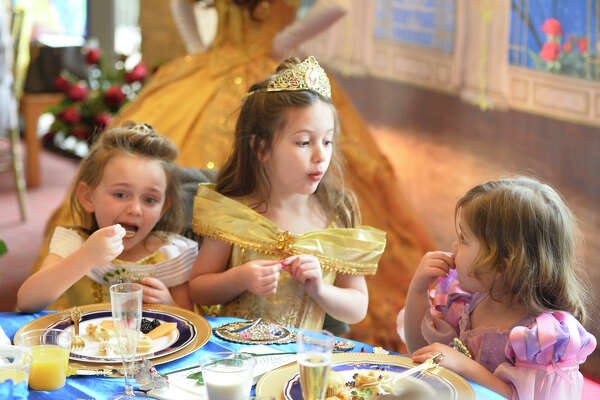"From left, Izzy Lambdin, Quinlyn Windham, and Claiborne Griffis enjoy the Breakfast with Belle event featuring appearances by cast members of Midland Community Theater's production ""Beauty and the Beast,"" photographed Feb. 9, 2019, at MCT. James Durbin/Reporter-Telegram"