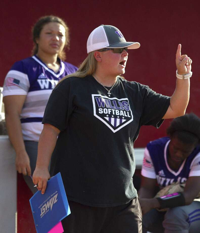 Willis first base coach Lyndsey Lipscomb calls a defensive shift during the sixth inning in Game 2 of a Region III-5A final high school softball series at Cougar Softball Stadium, Saturday, May 27, 2017, in Houston. Photo: Jason Fochtman, Staff Photographer / Houston Chronicle / © 2017 Houston Chronicle