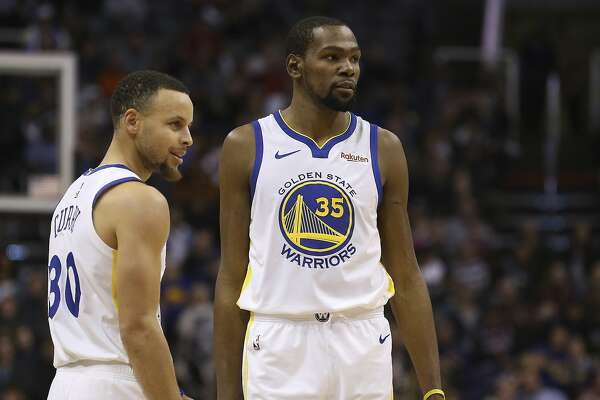 a4e7c0a931e7 1of4Golden State Warriors guard Stephen Curry (30) and forward Kevin Durant  (35) pause during the first half of an NBA basketball game against the  Phoenix ...