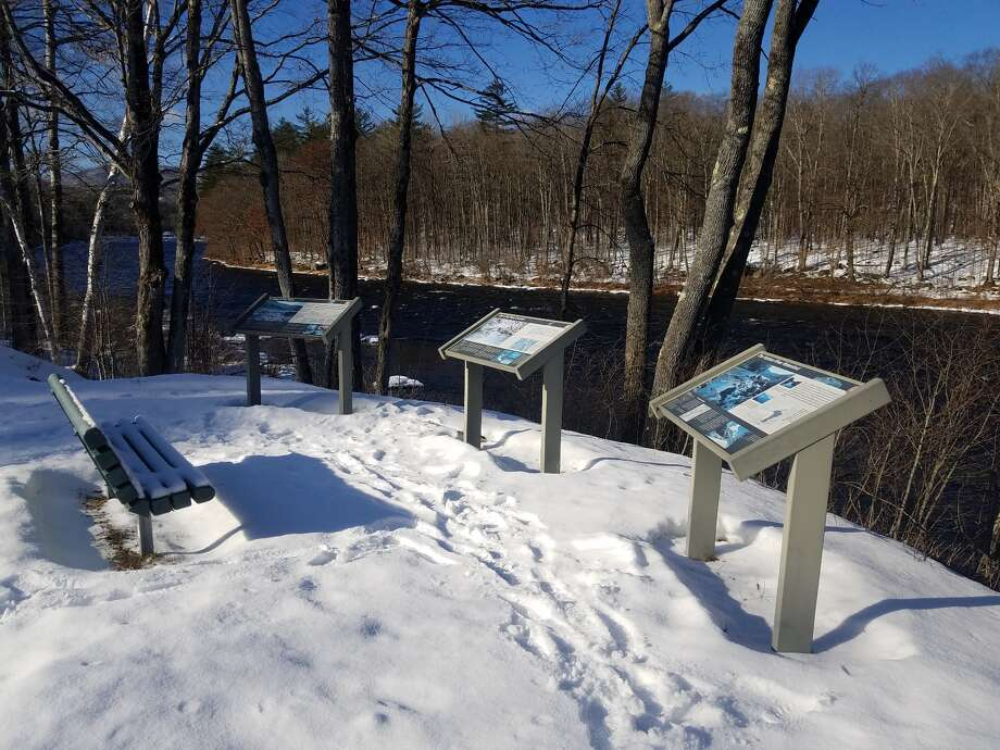 Existing signs along Route 28 between the hamlets of North River and North Creek in the Adirondacks. A Scenic Byways sign project will update and enhance existing interpretive signs.  (Photo by Adirondack Research)