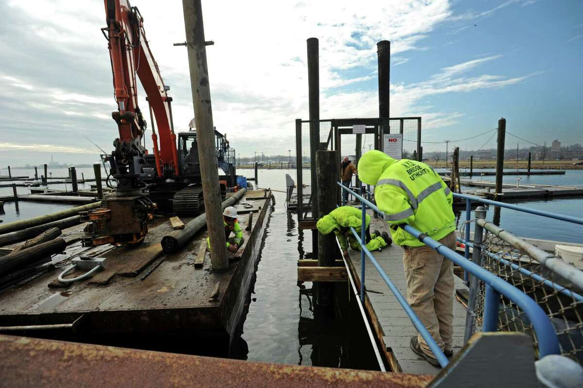 Norwalk Marine Construction replaces pilings at the Pastime Club Marina on Seaview Avenue Friday, February 8, 2019, in Norwalk, Conn.