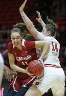 Stanford forward Alanna Smith (11) drives around Utah forward Andrea Torres (14) during the first half of an NCAA college basketball game Sunday, Jan. 27, 2019, in Salt Lake City. (AP Photo/Rick Bowmer)