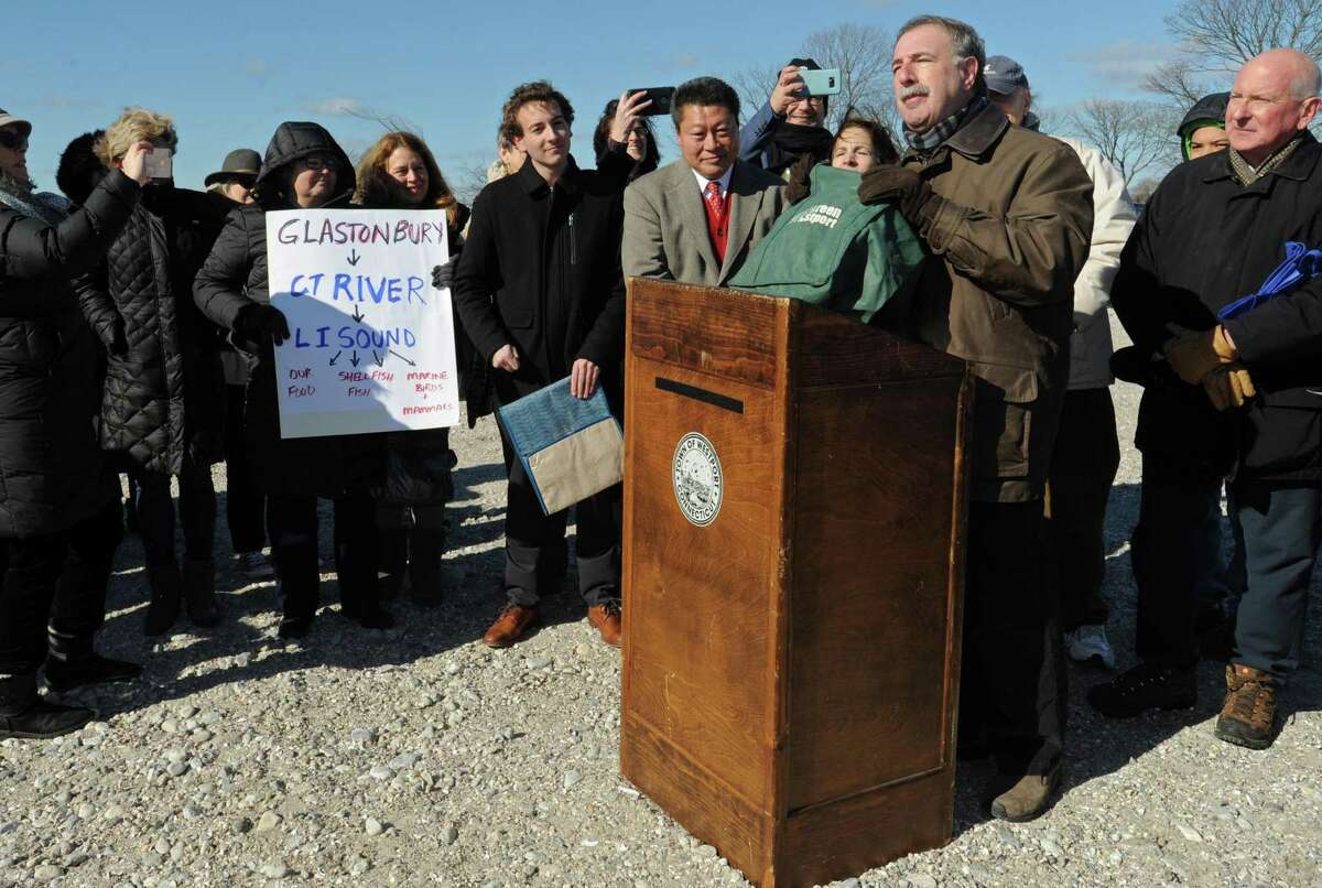 State Sen. Will Haskel, State Rep. Tony Hwang and State Rep. Jonathan Steinberg tout a bill that would ban single-use plastic bags in CT Saturday, February 9, 2019, while Westport First Selectman Jim Marpe and residents looks on at Compo Beach in Westport, Conn.