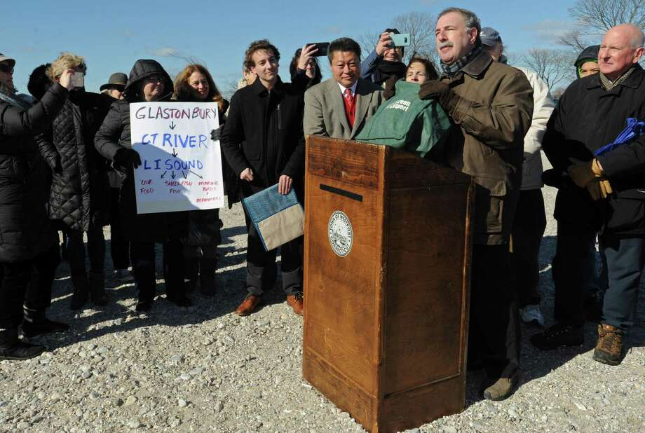 State Sen. Will Haskel, State Rep. Tony Hwang and State Rep. Jonathan Steinberg tout a bill that would ban single-use plastic bags in CT Saturday, February 9, 2019, while Westport First Selectman Jim Marpe and residents looks on at Compo Beach in Westport, Conn. Photo: Erik Trautmann / Hearst Connecticut Media / Norwalk Hour