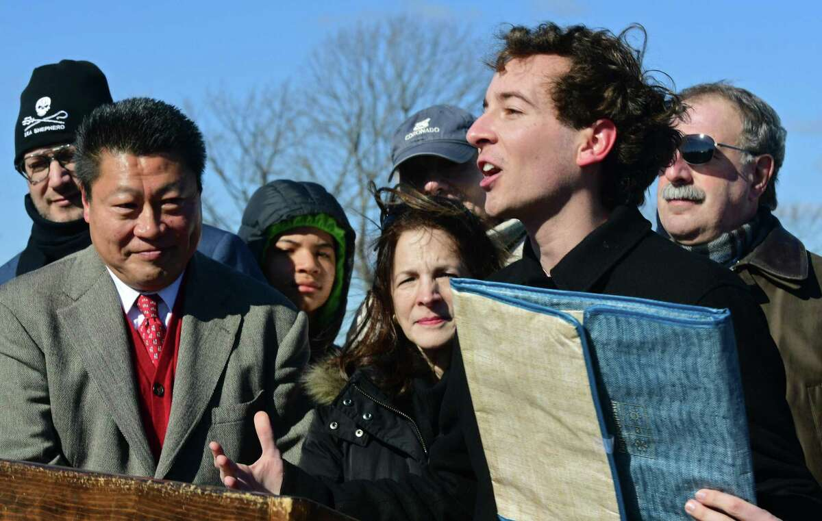 State Sen. Will Haskell, State Rep. Tony Hwang, State Rep. Gail Lavielle and State Rep. Jonathan Steinberg tout a bill that would ban single-use plastic bags in Connecticut on Feb. 9 at Compo Beach in Westport.