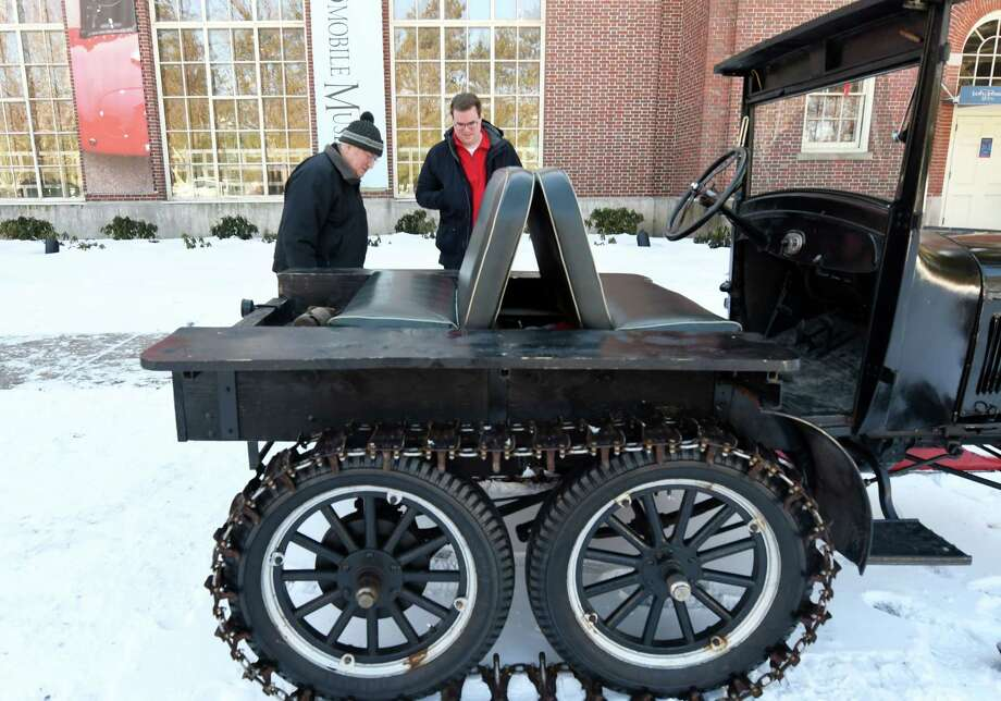 Bruce Morrow, left, and Logan Morrow look at a Model T snowmobile Saturday, Feb. 9, 2019 at the Saratoga Automobile Museum in Saratoga Springs, NY. (Phoebe Sheehan/Times Union) ORG XMIT: 40046140A Photo: Phoebe Sheehan / 40046140A
