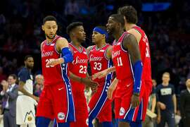 The Philadelphia 76ers', from left, Ben Simmons, Jimmy Butler, Tobias Harris, James Ennis, and Boban Marjanovic congratulate one another after a timeout in the second quarter against the Denver Nuggets at the Wells Fargo Center in Philadelphia on Friday, Feb. 8, 2019. The Sixers won, 117-110. **FOR USE WITH THIS STORY ONLY**(Mitchell Leff/Getty Images/TNS)