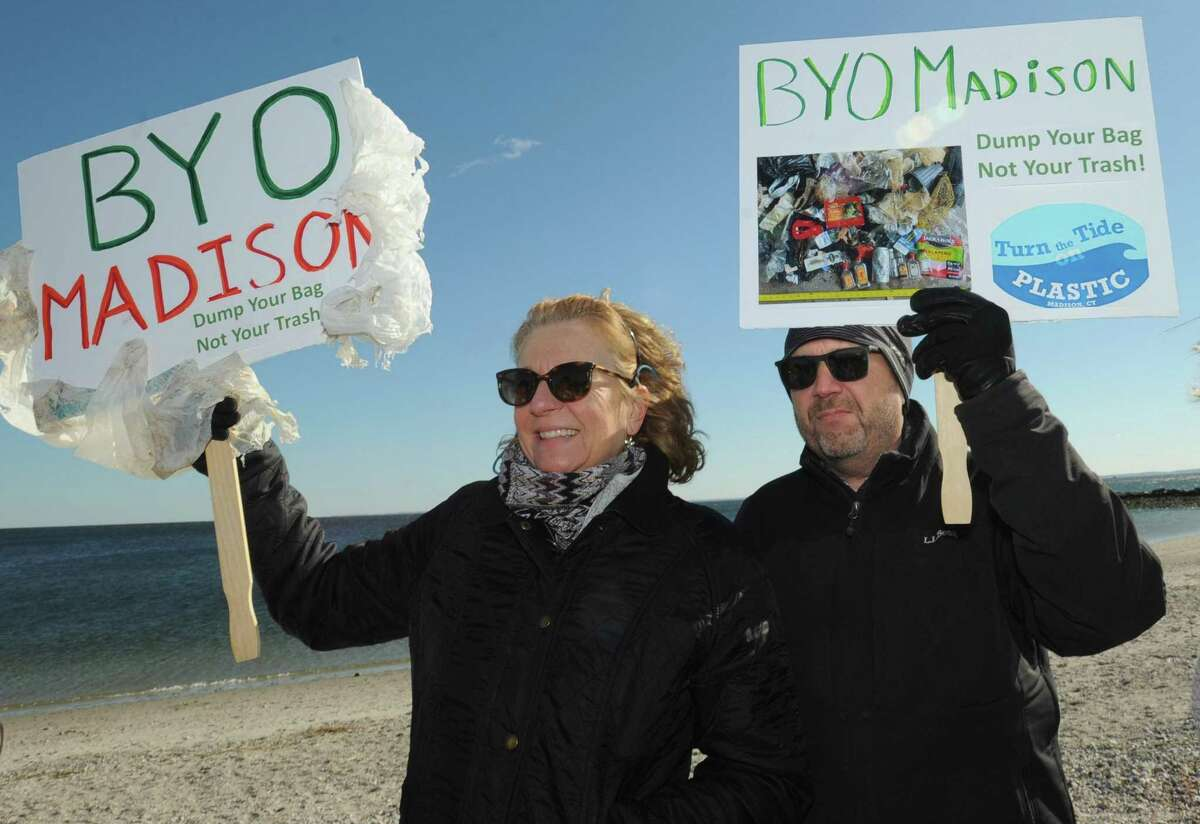 Kellie Brady and her husband, Francis Brady, of Madison listen to state Sen. Will Haskel and state Rep. Jonathan Steinberg tout a bill that would ban single-use plastic bags Feb. 9 at Compo Beach in Westport.
