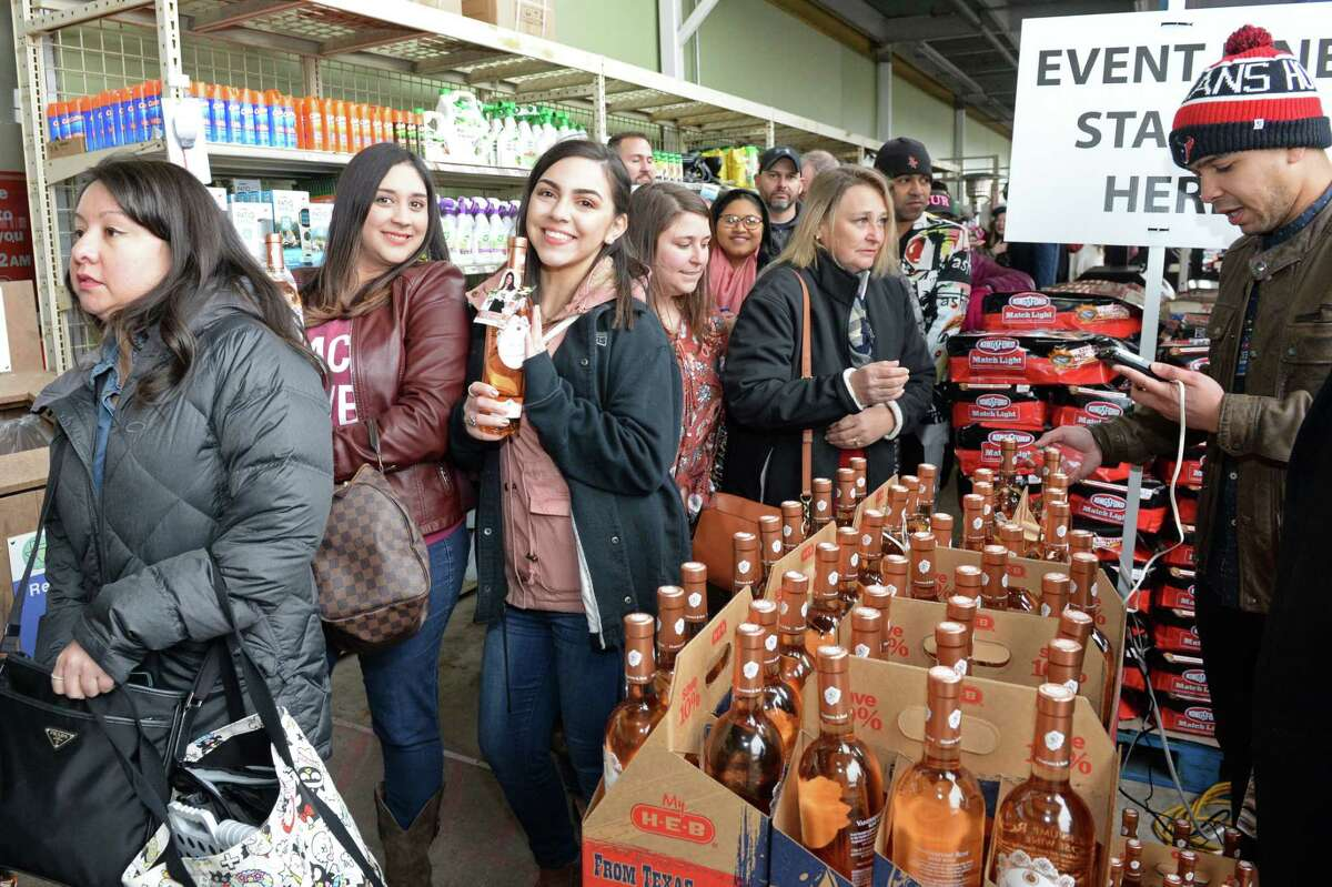 Fans of Lisa Vanderpump purchase bottles of Vanderpump Rose as they wait in line for an autograph at the Grand Parkway H-E-B in Katy, on Saturday, February 9, 2019.