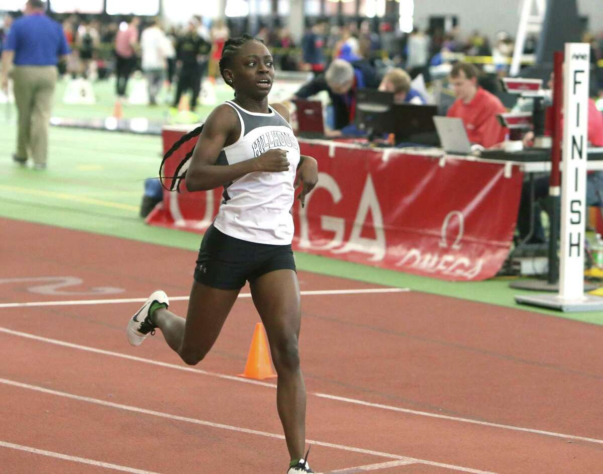 Jada Boyd, of Hillhouse High School, crosses the finish line to win the fourth heat of the 600 Meter run in the CIAC Class M track and field championship at the Floyd Little Athletic Center in New Haven on Saturday, Feb. 9, 2019. Boyd won the finals with a time of 1:36.98.