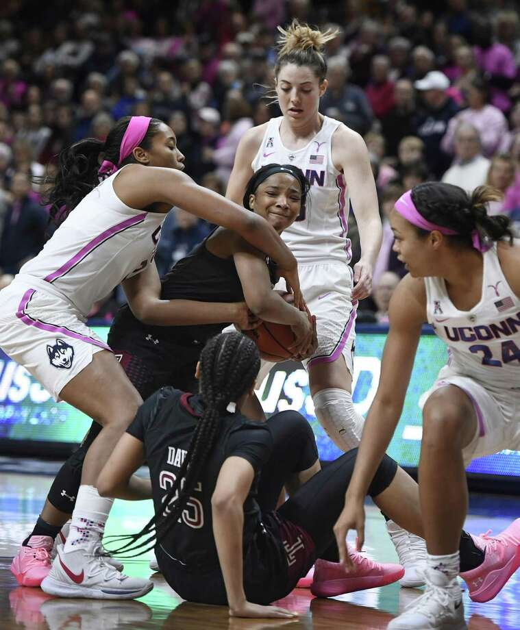 UConn's Megan Walker, left, pressures Temple's Alliya Butts during the first half of on Saturday in Storrs. UConn's Katie Lou Samuelson, top, UConn's Napheesa Collier, right, and Temple's Mia Davis, bottom, look on. Photo: Jessica Hill / Associated Press / Copyright 2019 The Associated Press. All rights reserved