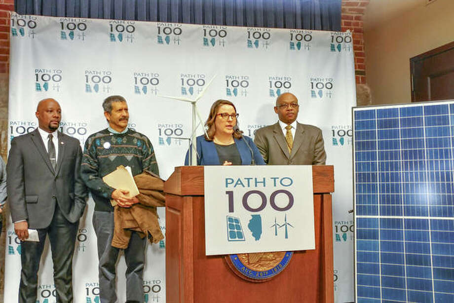 Amy Heart, Midwest chair for Solar Energy Industry Association and policy director for Sunrun, is joined by fellow green energy advocates and Rep. Will Davis, D-Hazel Crest, at a news conference Wednesday at the Illinois Capitol announcing green energy legislation. The Path to 100 bill, which Davis will announce within two weeks, will be aimed at moving Illinois toward 100 percent renewable energy. Photo: Capitol News Photo By Jerry Nowicki