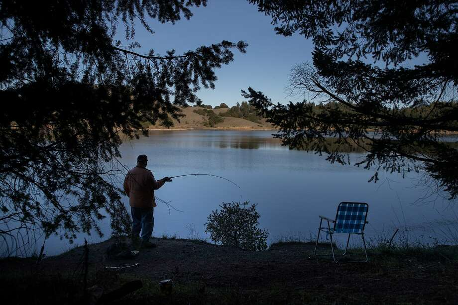 Tom Bujakowski brings a lawn chair to fish for trout at Bon Tempe Lake on Friday, Dec. 28, 2018, in Marin County, Calif. Photo: Paul Kuroda / Special To The Chronicle