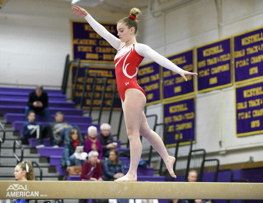 Greenwich's Kelsey Fedorko competes on the beam in the Ro Carlucci FCIAC gymnastics championship at Westhill High School in Stamford on Saturday. Photo: Matthew Brown / Hearst Connecticut Media / Stamford Advocate
