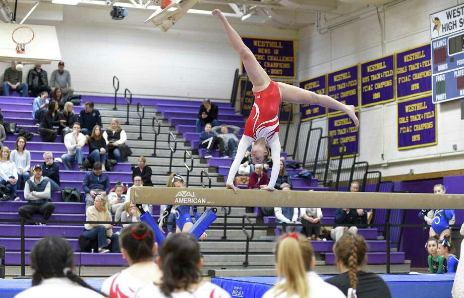 Greenwich's Kelsey Fedorko competes on the beam in the Ro Carlucci FCIAC championship meet Feb. 9. Photo: Matthew Brown / Hearst Connecticut Media / Stamford Advocate