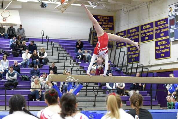 Greenwich's Kelsey Fedorko competes on the beam in the Ro Carlucci FCIAC championship meet Feb. 9.