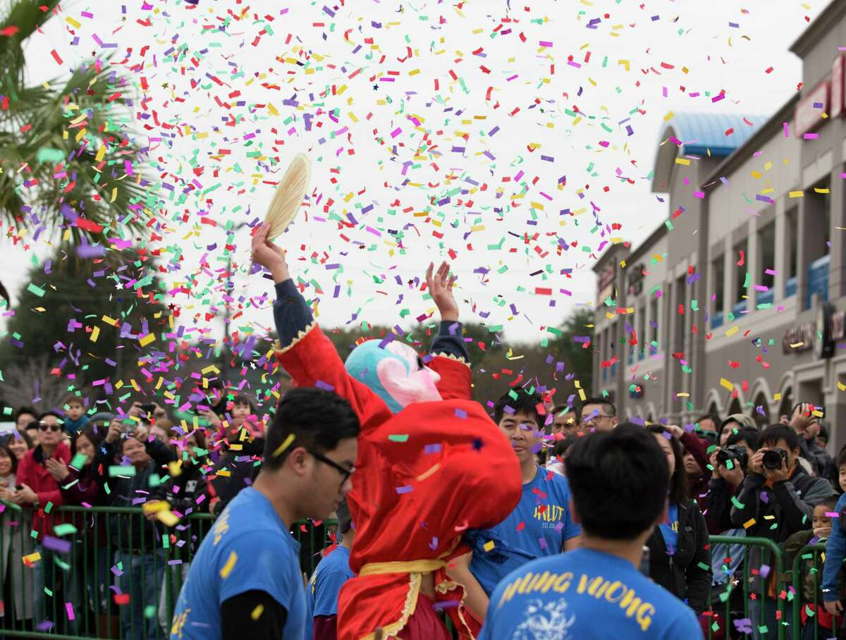 The Ong Dia Buddha cheers under confetti at the end of the Hung Vuong Lion Dance Team performance during the Lunar New Year Houston Festival at Viet Hoa Center on Saturday, Feb. 9, 2019, in Houston. Ong Dia Buddha is believed to bring good luck and fortune.