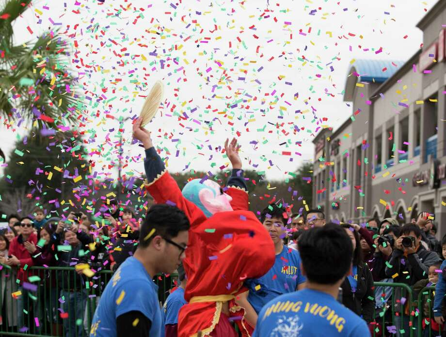 The Ong Dia Buddha cheers under confetti at the end of the Hung Vuong Lion Dance Team performance during the Lunar New Year Houston Festival at Viet Hoa Center on Saturday, Feb. 9, 2019, in Houston. Ong Dia Buddha is believed to bring good luck and fortune. Photo: Yi-Chin Lee, Houston Chronicle / © 2019 Houston Chronicle
