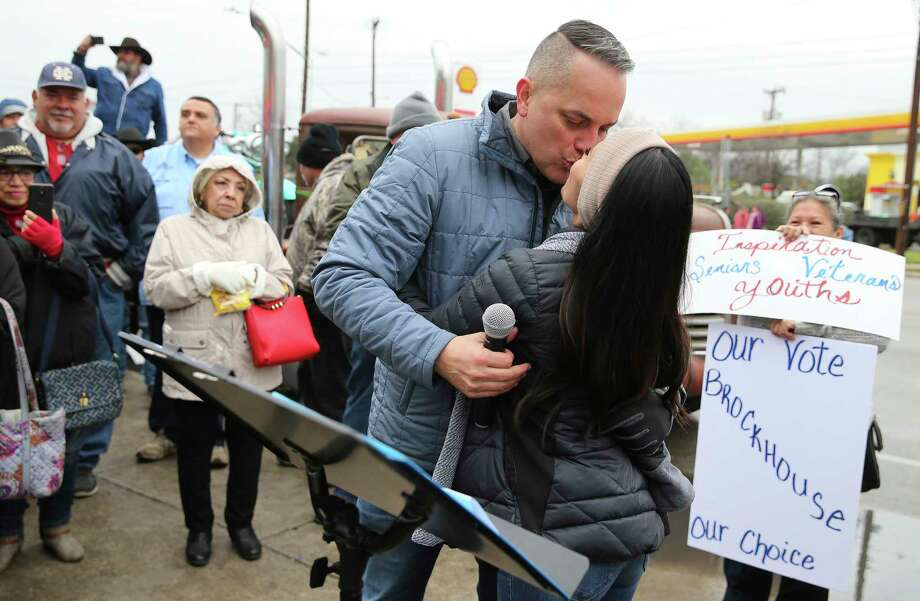 District 6 Councilman Greg Brockhouse kisses his wife, Annalisa, as he announces his bid for city mayor in front of family, friends and supporters just outside Del Bravo Record Shop along Old Highway 90 on a chilly afternoon on Saturday, Feb. 8, 2019. Brockhouse took direct aim at current mayor Ron Nirenberg for his lack of vision for the city. Brockhouse cited several points he would improve: job creation, wage inequality, economic development, lower property taxes, transparency in government and improve public safety relations. Brockhouse's father, the Rev. David Brockhouse started the event off with an invocation and then Brockhouse's wife, Annalisa, introduced the councilman during the announcement. Photo: Kin Man Hui, San Antonio Express-News / ©2019 San Antonio Express-News