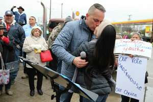 District 6 Councilman Greg Brockhouse kisses his wife, Annalisa, as he announces his bid for city mayor in front of family, friends and supporters just outside Del Bravo Record Shop along Old Highway 90 on a chilly afternoon on Saturday, Feb. 8, 2019. Brockhouse took direct aim at current mayor Ron Nirenberg for his lack of vision for the city. Brockhouse cited several points he would improve: job creation, wage inequality, economic development, lower property taxes, transparency in government and improve public safety relations. Brockhouse's father, the Rev. David Brockhouse started the event off with an invocation and then Brockhouse's wife, Annalisa, introduced the councilman during the announcement.
