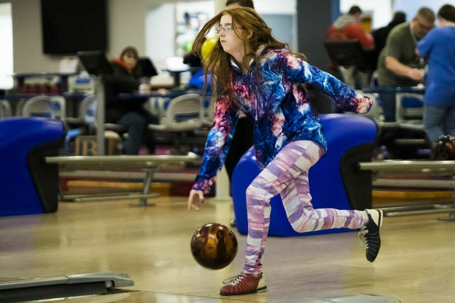Midland resident Grace Henriquez, 13, sends a bowling ball down the lane during a youth bowling league meet on Saturday, Feb. 9, 2019 at Valley Lanes in Midland. (Katy Kildee/kkildee@mdn.net) Photo: (Katy Kildee/kkildee@mdn.net)