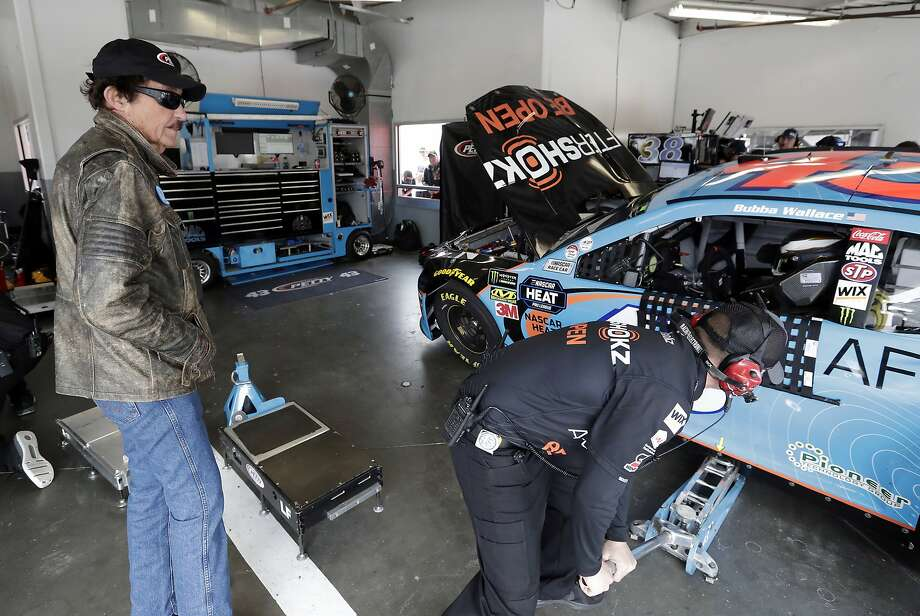 Team owner Richard Petty, left, looks over the car of Darrell Wallace Jr. in the garages during NASCAR auto race practice at Daytona International Speedway, Saturday, Feb. 9, 2019, in Daytona Beach, Fla. (AP Photo/John Raoux) Photo: John Raoux / Associated Press