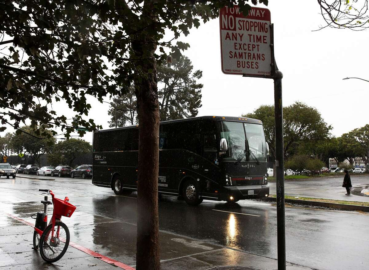 A bus drives along Drumm Street and past Washington Street on Saturday, Feb. 9, 2019, in San Francisco, Calif. The entire block of parking on the west side of Drumm Street has been taken out of service to make room for a rest stop for SamTrans bus drivers.