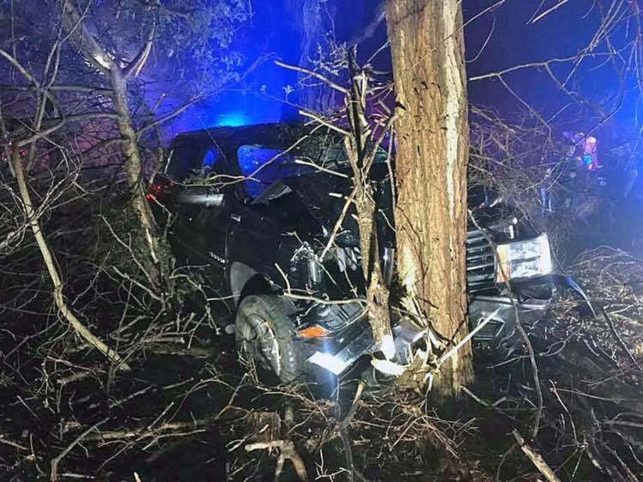 Firefighters worked the scene of a truck that crashed into a tree in Monroe, Conn., on Feb. 7, 2019. Photo: Contributed Photo / Monroe Volunteer Fire Department / Contributed Photo / Connecticut Post Contributed