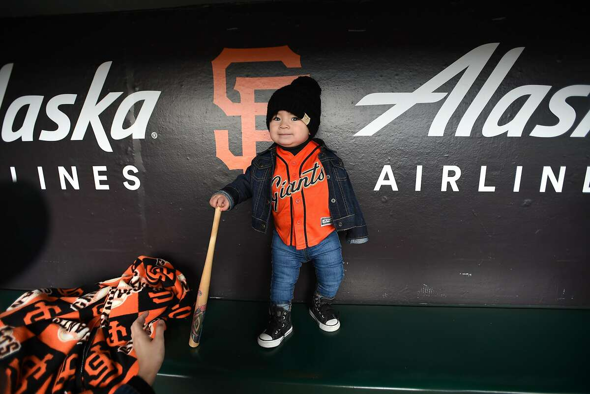 Victoria Santos, Age 1, enjoys visiting the dugout during the Giants' FanFest at the ballpark event at Oracle Park in San Francisco on February 09, 2019. In spite of rainy weather, fans arrived in force to meet players and get their paraphernalia autographed.